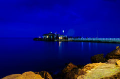 Epic Island Night Scenery. Epic and poetic scenery of an island in the night with building lights reflecting from the surface of the sea Royalty Free Stock Photo