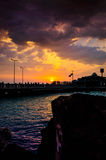 Epic Island Sunset Scenery. Epic and poetic scenery on an island in the sunset with majestic clouds and sun lights reflecting from the surface of the sea with Royalty Free Stock Photography