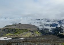 Epic landscape around plateau of Morinsheidi with mountains and glaciers in the clouds, between the Eyjafjallajokull and royalty free stock images