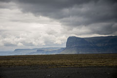 Epic Landscape in Iceland with green grass and mountain rocks Royalty Free Stock Image