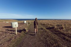 Epic Landscape with small people. Slpoe Point, The Catlins, New Zealand Royalty Free Stock Photo