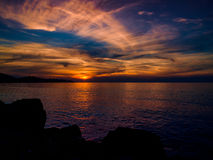 Epic Mid Season Sunset. Epic sunset with majestic clouds and glorious sun on the horizon during the mid season times on shoreline of Marmara region of country Royalty Free Stock Photo