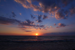 Epic Ocean Sunset. Sun on the horizon, bold clouds Royalty Free Stock Photo