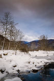Epic Pastoral Winter Landscape. Epic and beautiful natural landscape in the season of winter with lots of natural details from diversity of vegetation to walking Stock Image