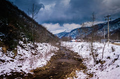 Epic Pastoral Winter Landscape. Epic and beautiful natural landscape in the season of winter with lots of natural details from diversity of vegetation to walking Royalty Free Stock Photos