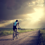 Epic Photo of Cyclist on Dramatic Sky Background Royalty Free Stock Photos
