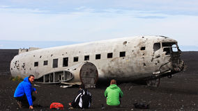 The epic plane wreck on the black beach in South Iceland. In 1973 a United States Navy DC plane ran out of fuel and crashed on the black beach at Sólheimasandur Royalty Free Stock Image