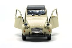 An epic front Citroen 2CV car. Front view of an a Citroen 2CV two horses power toy car with door opened isolated against white background stock image