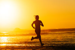 Epic runner training on summer sunset Stock Photography