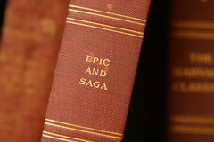 Epic and saga. Closeup, selective focus image of an old worn book spine. background of additional out of focus book Stock Photo