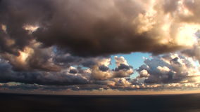 Epic Stormy Timelapse Sunset Clouds Over The Sea stock footage