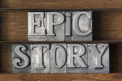 Epic story. Phrase made from metallic letterpress type on wooden tray Stock Photos