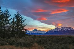 Epic sunrise at Aoraki Mount Cook National Park. Epic sunrise with striking red lenticular clouds at Glentanner Park, Aoraki Mount Cook National Park, South Royalty Free Stock Photography