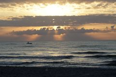 Epic Sunrise over the ocean. In Cocoa Florida. Waves roll and break at the shoreline Stock Image