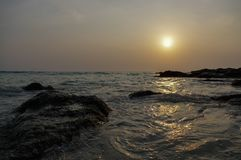 Epic sunset over beach with rocks and sea, emotion vacation and holidays tourism traveller having fun. Thailand Royalty Free Stock Photos