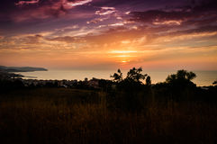 Epic Sunset Over The Sea With Natural Landscape Stock Image