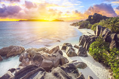Epic sunset on Seychells. The most beautiful beach of Seychelles - Anse Source D'Argent at sunset Stock Image