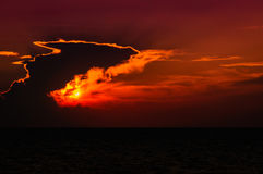 Epic Suset Sky With Majestic Clouds. Epic sunset scenery with majestic clouds and the sun that looks like a fireball over the sea Royalty Free Stock Photo