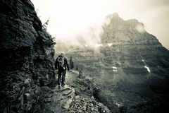 Epic trail hike at Glacier National Park. An stormy hike at Glacier National Park, Montana Royalty Free Stock Image