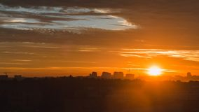 Epic urban sunrise. Epic sunrise with beautiful clouds and building on horizon. Time lapse stock video