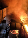 Epic view of blast iron processing (metal fire smoke technology). Metallurgy even plays a role in the production of metals, from extracting from ores to the Royalty Free Stock Images