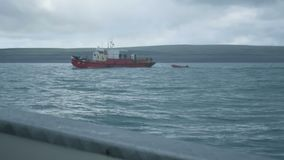 Epic view of fishing toristic boat at north summer Barents sea, stormy weather, waves stock video