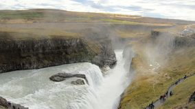 Epic view on icelandic waterfall Gullfoss and Hvita river valley at the bottom, tourists are walking. Over pedestrian roads, in fall day stock footage