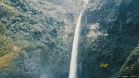 Epic waterfall Nature background full hd. High Humidity In Jungle Rainforest with a powerful waterfall