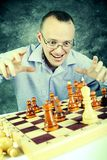 Epic win. The young man playing chess Royalty Free Stock Images
