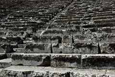 Epidaurus. Detail of sets at ancient Greek amphitheater of Epidaurus at sunny summer day Stock Image