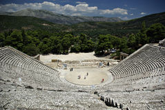 Epidaurus. Detail of seats at ancient Greek amphitheater of Epidaurus at sunny summer day Stock Photos