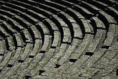 Epidaurus. Detail of seats at ancient Greek amphitheater of Epidaurus at sunny summer day Stock Image