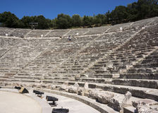 The Epidaurus Ancient Theatre. Is a theatre in the Greek city of Epidaurus, located on the southeast end of the sanctuary dedicated to the ancient Greek God of Royalty Free Stock Images
