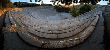 Epidaurus theater. Ancient theater in Epidaurus, Greece, 180 degrees panorama Royalty Free Stock Photography