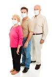 Epidemia - máscaraes protectoras desgastando imagens de stock royalty free