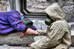 Epidemic. HDR. Person in gas mask with syringe Royalty Free Stock Photography