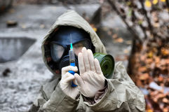 Epidemic. HDR. Person in gas mask with syringe Stock Photography