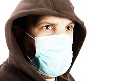 Epidemic. Portrait of a man with a surgical mask on a white background Royalty Free Stock Images