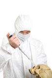 Epidemic. Doctor with dropper in the one hand and skull in the other one Royalty Free Stock Photography