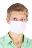 Epidemic. Closeup image of the handsome young man in the medical mask Royalty Free Stock Photo