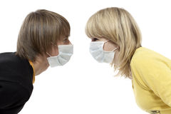 Epidemic comes. Portrait of young boy and girl in respirator bandage on Stock Image