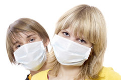 Epidemic comes. Portrait of young boy and girl in respirator bandage on Stock Photography