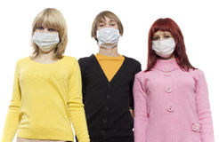 Epidemic comes. Three teenagers in protective respirator bandage on Royalty Free Stock Images