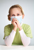 Epidemic. Portrait of a sad girl in face mask Stock Images