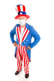 Epidemic - Uncle Sam. Uncle Sam wearing a surgical mask to protect against congatious illness. Full body isolated stock photo