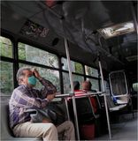 Epidemics in a bus in Mexico. People looking with fear one after another because of the epidemics in a bus Royalty Free Stock Photo