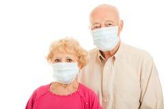 Epidemie - älteres Paar stockbild