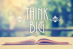 Epigraph over the opened book with elegant ornament - Think big stock image