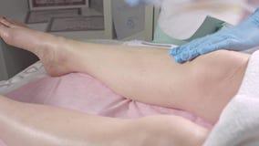 Epilation on the legs stock video footage