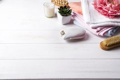 Epilator with bath accessories on white background. Epilator with bath accessories on white wooden background. Beauty and skin care concept, copy space Stock Photography